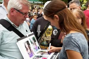 Famous professional mermaid Kat signing autographs