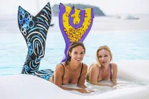 Mermaid Instructor Kat and Mermaid Student Maria performing at Kata Rocks in Phuket
