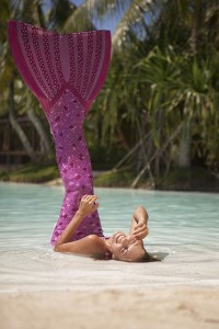 Mermaid Kat laughing on her back in Australia
