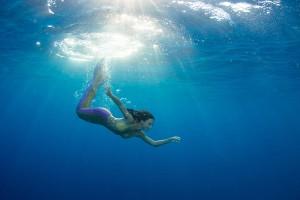 Professional underwater mermaid model Kat swimming underwater in the Red Sea