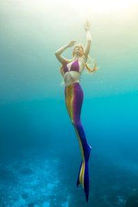 Real mermaid and underwater model