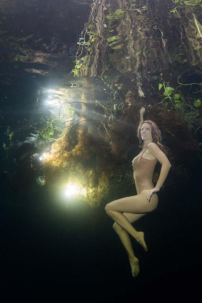 Katrin Gray modelling underwater at Oxman Cenote in Mexico
