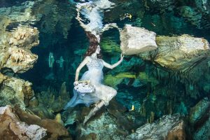 Underwater fashion model Mermaid Kat at Cenote Hilario in Mexico