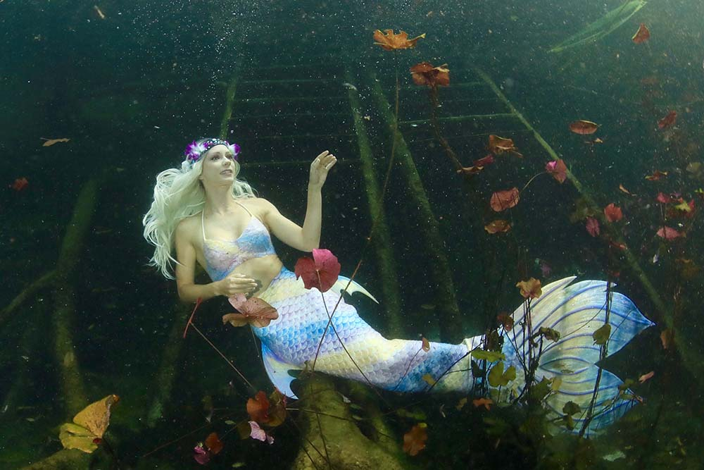 Underwater model Mermaid Kat posing at Carwash Cenote in Mexico