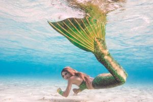 Professional mermaid Kat swimming in the Maldives