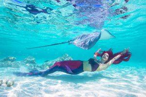 Underwater model Mermaid Kat swimming with sting rays during Mermaid Week Tahiti 2019