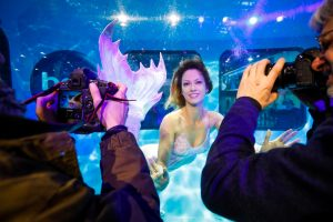 Professional Mermaid Kat performs in underwater tank