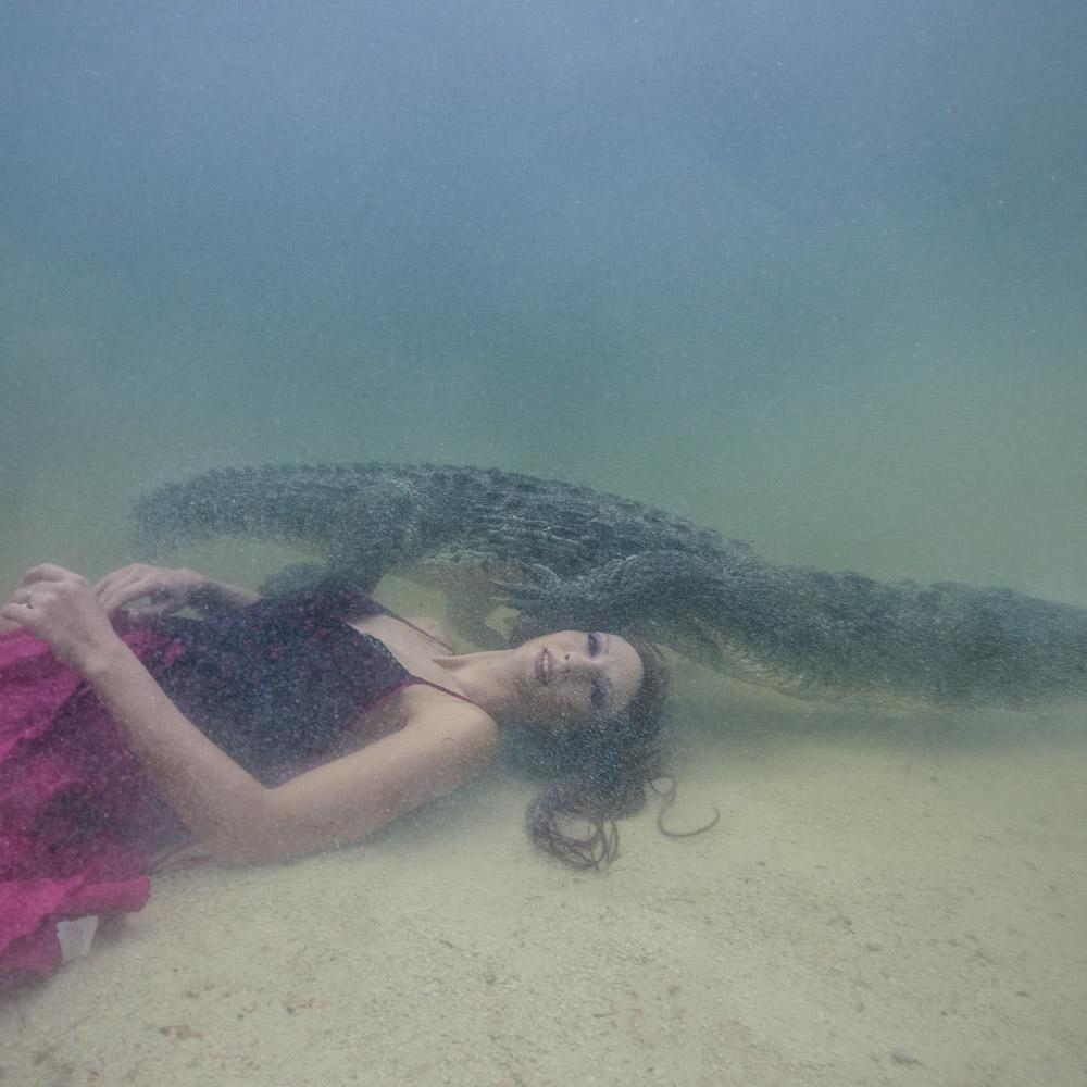 Underwater Model swims with Crocodiles