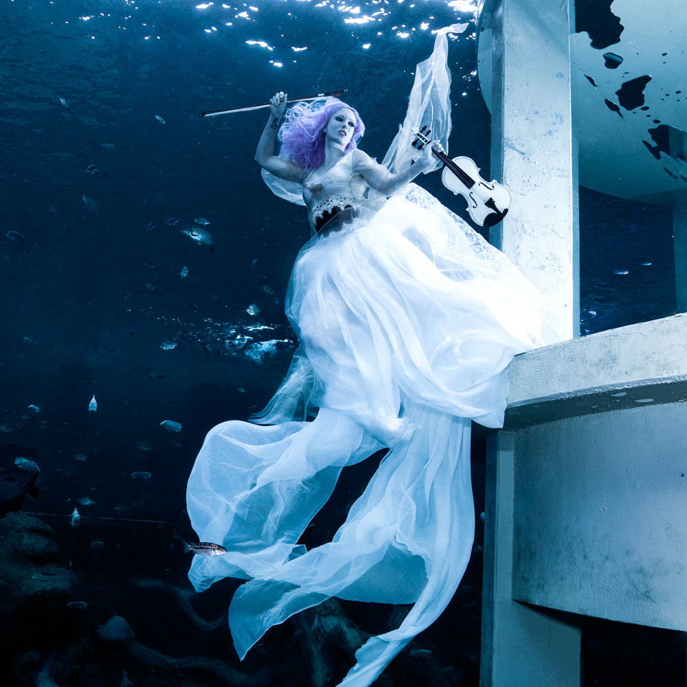 Mermaid Kat is an underwater stunt woman and underwater fashion model